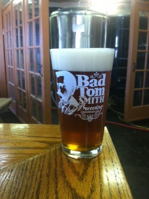 A beer from Bad Tom Smith Brewing.