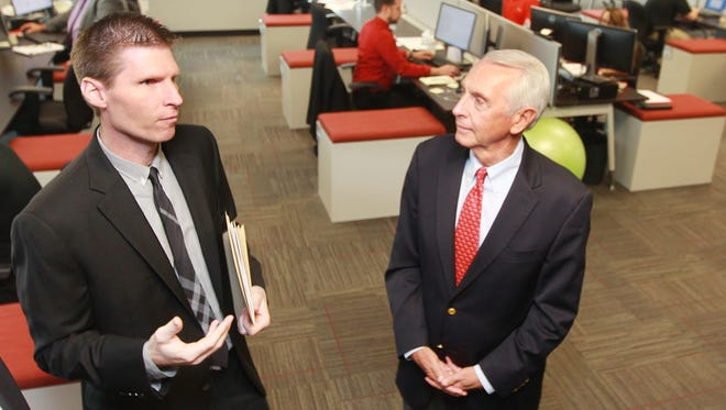 XPO Logistics Inc. COO Troy Cooper (left) talsk with Gov. Steve Beshear during a visit to the company's Newport office  to announce its $2.7 million expansion.