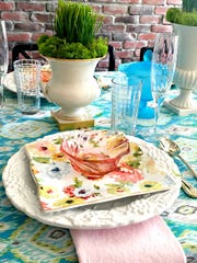 Pieces of fabric can be used instead of a formal tablecloth and runners for a festive table setting.