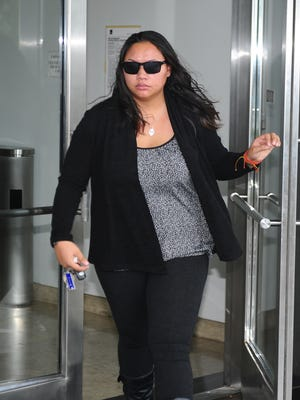 Coleen Renee Reyes exits the District Court of Guam building in Hagåtña on Tuesday, Aug. 29, 2017. Reyes appeared in court for the reading of her verdict after a jury found her guilty of attempted possession of methamphetamine with the intent to distribute.