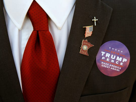 Zach Germany of Forest Lake, Minn., waits in line with other supporters of Republican presidential candidate Donald Trump, before a campaign stop at the Minneapolis International Airport Sunday, Nov. 6, 2016, in Minneapolis.