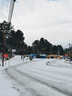 Roads in midtown Ruidoso were snow packed and icy from a fast-moving snowstorm Friday morning.
