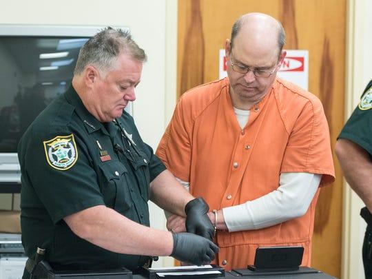 Charles McMullen gets fingerprinted after sentencing