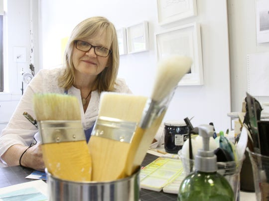 Artist Susan Walsh at work in her studio space in an