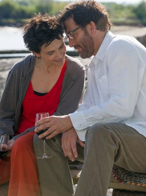 "Juliette Binoche and Clive Owen in ""Words and Pictures."""
