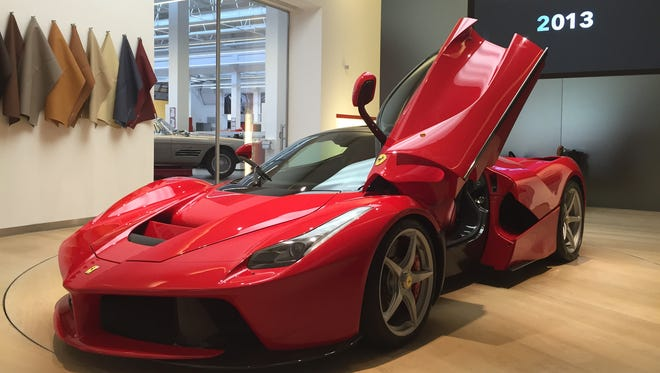 A 2015 Ferrari LaFerrari hybrid car. The LaFerrari is Ferrari's first hybrid. It combines an electric motor that produces more than 161 horsepower with a V12 engine that produces 789 horsepower. It costs $1.4 million and only 499 have been made.