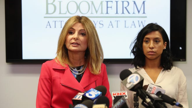 Lisa Bloom, left, attorney for Montia Sabbag talks with the media about the alleged attack on her client's character at a news conference Tuesday in Woodland Hills, Calif.