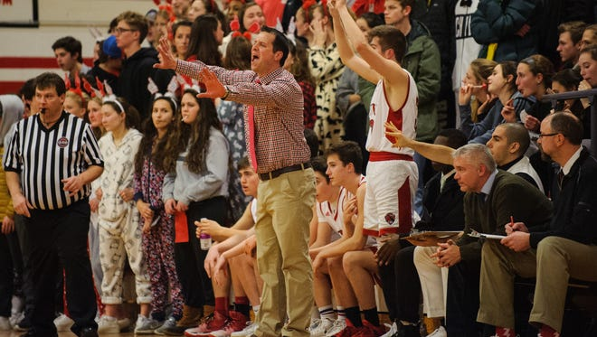 CVU head coach Michael Osborne yells to the team on the court during the boys basketball game between the Burlington Seahorses and the Champlain Valley Union Redhawks at CVU High School on Tuesday night February 13, 2018 in Hinesburg. (BRIAN JENKINS/for the FREE PRESS)