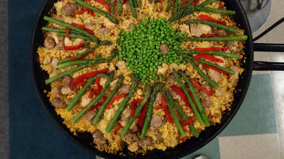 Paella Campesina with chicken, pork, garbanzos and