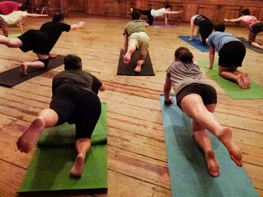 Yoga students take part in a class lead in French at