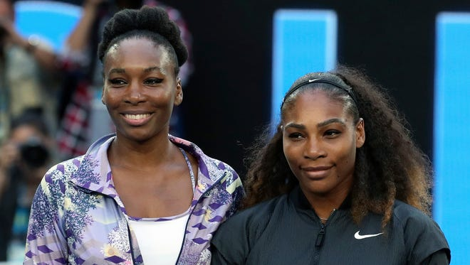 Venus and Serena Williams will help the United States begin its Fed Cup title defense.
