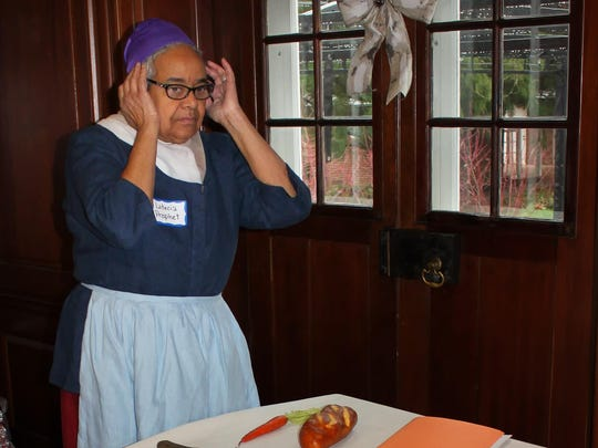 Leticia Prophet, who was unexpectedly unable to pose for a photo playing Amelia Shadd, here plays a cook in a murder mystery.
