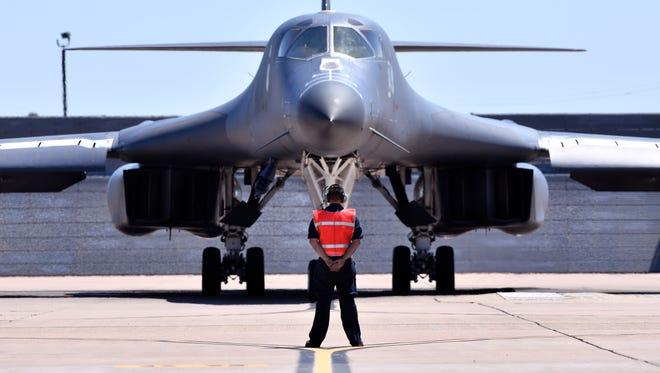 An airman waits to direct a Dyess Air Force Base B-1 bomber April 26, 2018.