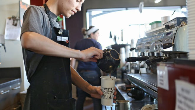 Edgar Montes creates a beverage at Sip Coffee House and Juice Bar in Indio, Tuesday, October 27, 2015.