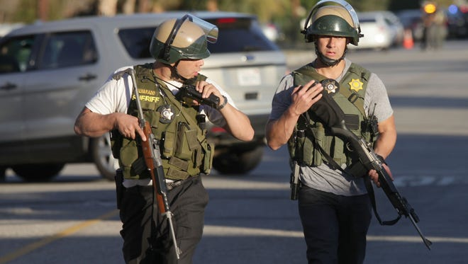 A large number of police search the area near Victoria Ave in connection with the shooting in San Bernardino, December 2, 2015.