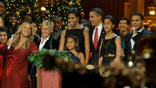 Ellen DeGeneres helps the Obamas celebrate Christmas In Washington in December 2010.