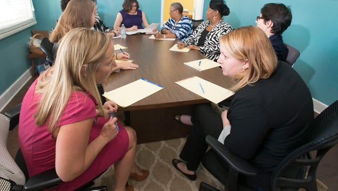 The legal team at Legal Services of North Florida holds their weekly staff meeting to review legal cases the organization has been asked to assist on. The Organization is celebrating its 40th anniversary helping poor people in need of legal services.