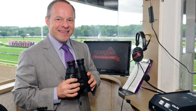 Former Churchill Downs announcer Larry Collmus in the booth at Saratoga.