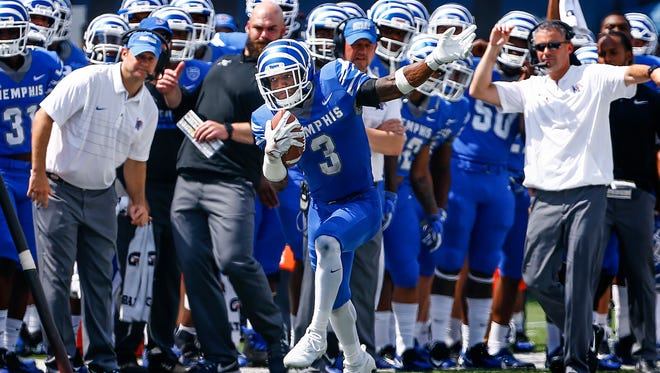 University of Memphis receiver Anthony Miller (middle) tip toes up the sideline for a positive gain against the UCLA defense during third quarter action at The Liberty Bowl Memorial Stadium in Memphis, Tennessee., Friday, September 16, 2017.