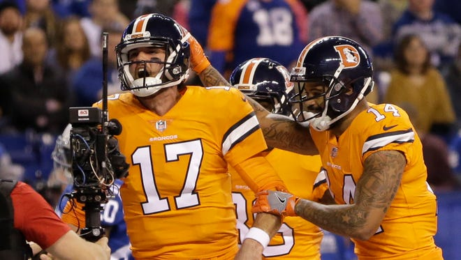 Denver Broncos quarterback Brock Osweiler (17) celebrates his rushing touchdown against the Indianapolis Colts during the first half of an NFL football game in Indianapolis, Thursday, Dec. 14, 2017. (AP Photo/AJ Mast)