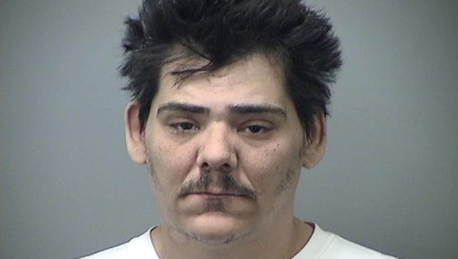 Jason Enrico Desmone, 38, was arraigned March 1, 2018, in Saginaw, Mich., charged with two counts of premeditated murder and two counts of first-degree felony murder in the deaths of his mother and sister in a Feb. 12, 2018, house fire.