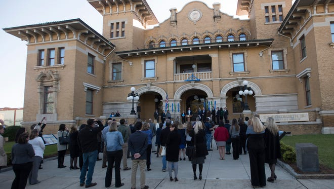 University of West Florida leadership and local government officials gather in the step of the T.T. Wentworth, Jr. Florida State Museum to kick off the university's Founders Week celebration, Monday, April 16, 2018. During the event, UWF unveiled its new flag design.