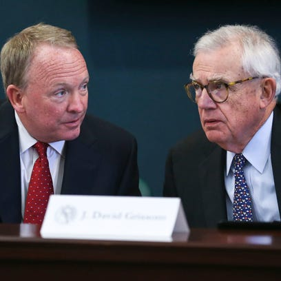 Interim Louisville President Greg Postel, left, talks