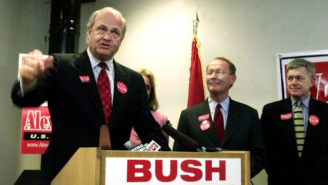 Sen. Fred Thompson, left, talks about bringing the party together to support Lamar Alexander in his bid for Thompson's Senate seat during a news conference Aug. 5, 2002.