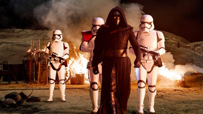 "Kylo Ren (Adam Driver) with Stormtroopers in ""Star Wars: The Force Awakens."""