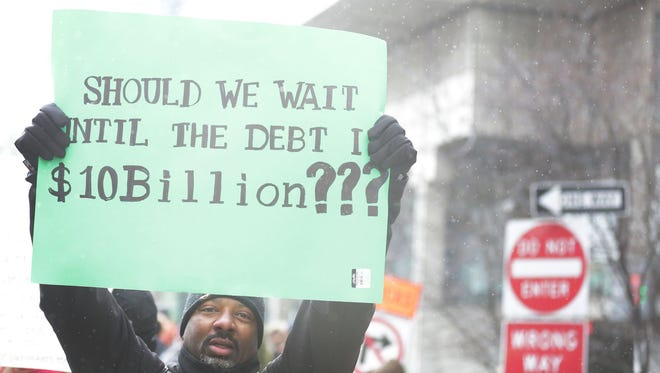 Detroit Public School teachers, students, parents and other supporters of the teacher sick-outs protest in front of Cobo Center on Jan. 20.