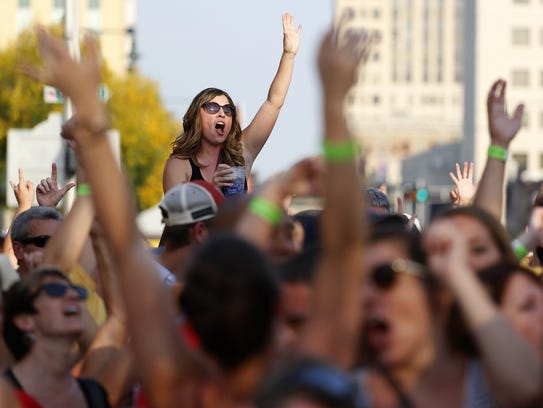 Fans sing along to Vic Ferrari during Octoberfest in