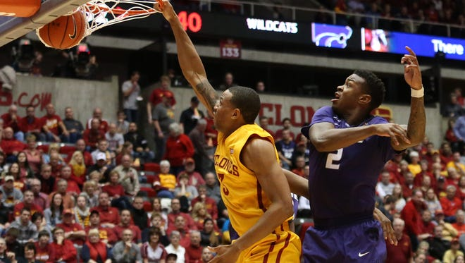 Iowa State senior Bryce Dejean-Jones dunks the ball over Kansas State sophomore Marcus Foster in the second half on Tuesday, Jan. 20, 2015, at Hilton Coliseum in Ames, Iowa.