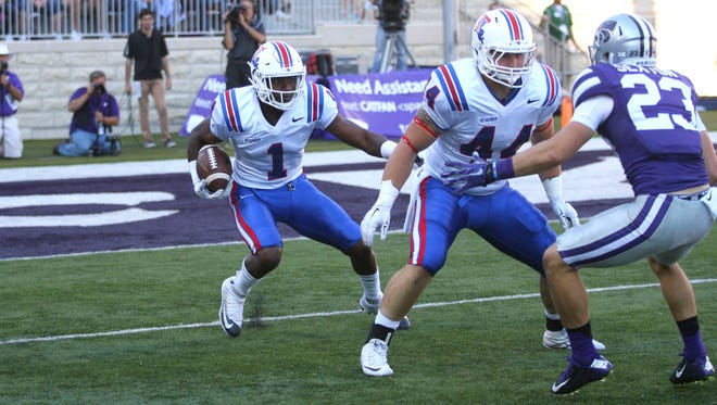 Louisiana Tech  wide receiver Carlos Henderson (1) follows the block of tight end Josh Gaston (44) on a kick return during a 39-33 triple overtime loss to the Kansas State Wildcats at Bill Snyder Family Football Stadium.
