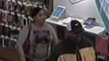 Two suspects wanted by police for fraudulent use of a credit card.