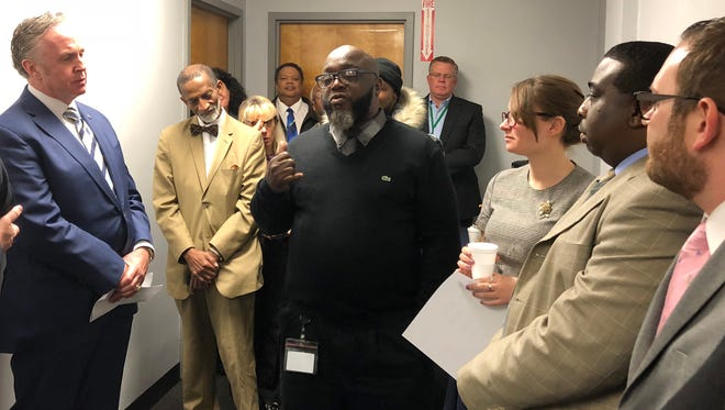 State Sen. Joseph Cryan (left) advocates, and friends listen to the testimony of NJRC client Charles Little as he discusses his journey from prison to employment.