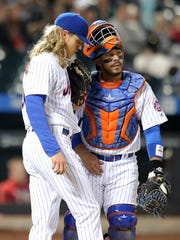 Mets catcher Rene Rivera talks to Noah Syndergaard during the third inning against the Philadelphia Phillies at Citi Field.