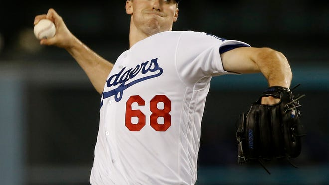 Los Angeles Dodgers starting pitcher Ross Stripling delivers to a San Diego Padres batter during the first inning of a baseball game in Los Angeles, Friday, Sept. 21, 2018. (AP Photo/Alex Gallardo)