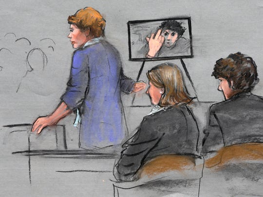 In this courtroom sketch, prosecutor Nadine Pellegrini makes opening arguments during the first day of the penalty phase in the trial of Boston Marathon bomber Dzhokhar Tsarnaev, seated at right, April 21, 2015, in federal court in Boston