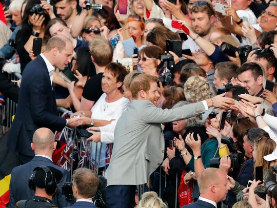 Prince William, top left, and Prince Harry, center,