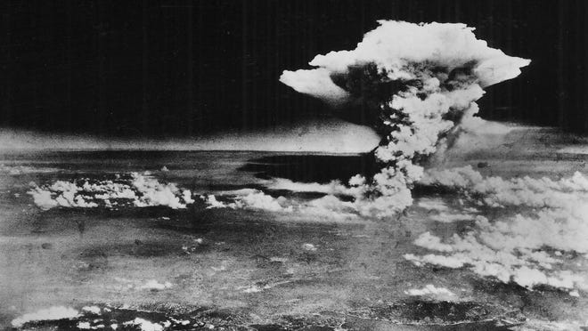 ** FILE - In this Monday, Aug. 6, 1945 picture made available by the U.S. Army via the Hiroshima Peace Memorial Museum, a mushroom cloud billows into the sky about one hour after an atomic bomb was detonated above Hiroshima, Japan.