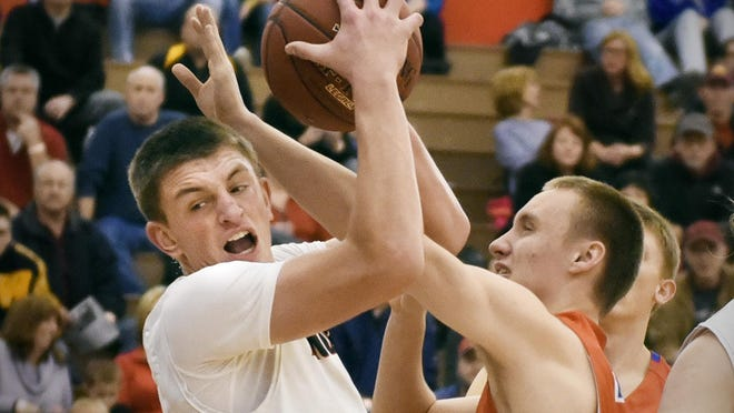 Rocori's Connor Schoborg pulls in a rebound over St. Cloud Apollo's Clayton Hoeper during the first half of The Breakdown Granite City Classic last year at Apollo. Schoborg and the Spartans return to this year's classic.