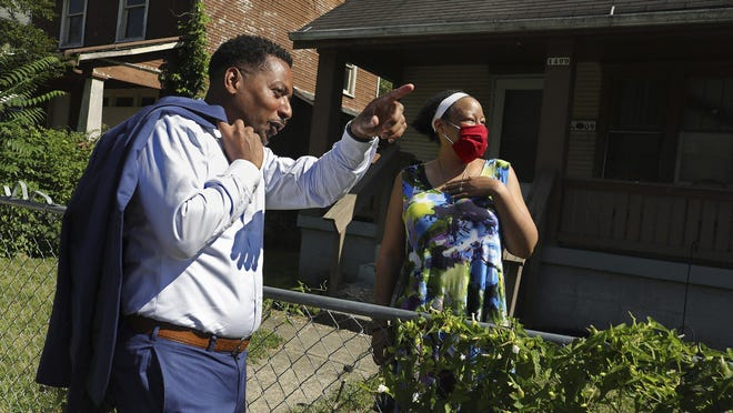 Franklin County Commissioner Kevin Boyce talks with longtime friend Candace Foster in front of her home on East Maynard Avenue, a street on which Boyce used to live. He has become a leader of efforts to address racism and disparities in the community.