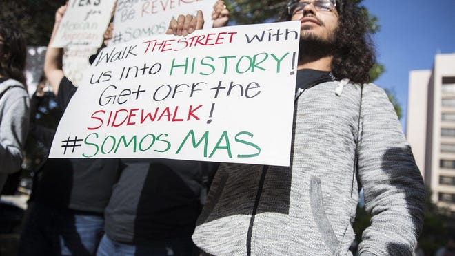 Isaiah Rodriguez joins a rally in front of the State Board of Education building before a preliminary vote on whether to create a statewide Mexican American studies course in April, 2018.