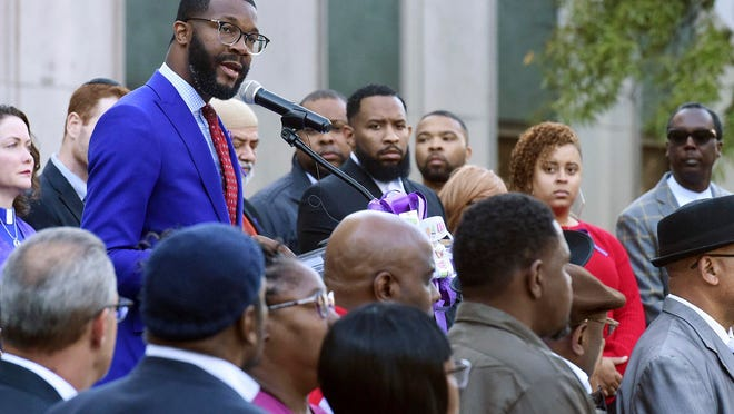 Birmingham Mayor Randall Woodfin speaks at a candlelight vigil in Birmingham, Ala., on Oct. 23, 2019. Officials say Woodfin has been hospitalized with COVID-19 pneumonia, five days after announcing he tested positive for the coronavirus.