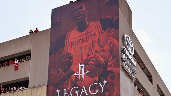 """A large photo of former great Houston Rockets """"Big Men"""" with Dwight Howard."""