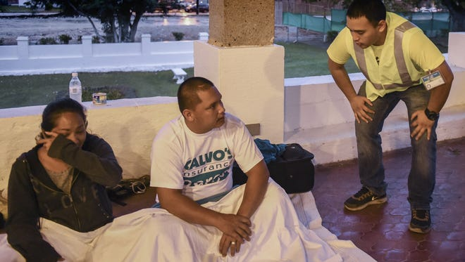From right, Jon Nguyen, volunteer, checks on Jonah Parages and Jolene-Vanesa San Agustin Santos, during a Guam Homeless Coalition annual count  in Agana on Jan 29.
