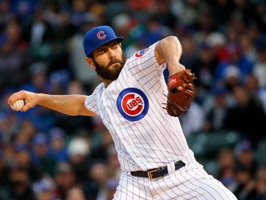 Chicago Cubs starting pitcher Jake Arrieta winds up during the first inning of the team's baseball game against the Philadelphia Phillies on Wednesday, May 3, 2017, in Chicago. (AP Photo/Charles Rex Arbogast)