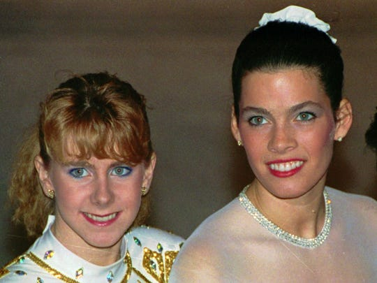 In this Jan. 12, 1992, file photo, Tonya Harding, left, and Nancy Kerrigan appear at the U.S. Figure Skating Championships in Orlando, Fla. It's been more than 20 years since Kerrigan was clubbed after practice in Detroit by a member of a bumbling goon squad hired by Harding's ex-husband with the hope of eliminating his former wife's top competition for the U.S. Olympic team.