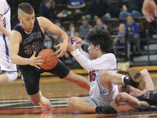 Lexington's Cade Stover gains control of a loose ball during the regional game against Bay Village at Bowling Green on Saturday.