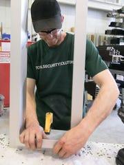 Josh Tinsley, aluminum shop assembler, puts together